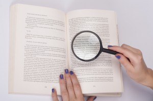 http://www.dreamstime.com/stock-photos-magnifying-glass-over-book-image28335293